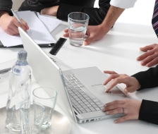 three persons in a bisiness meeting